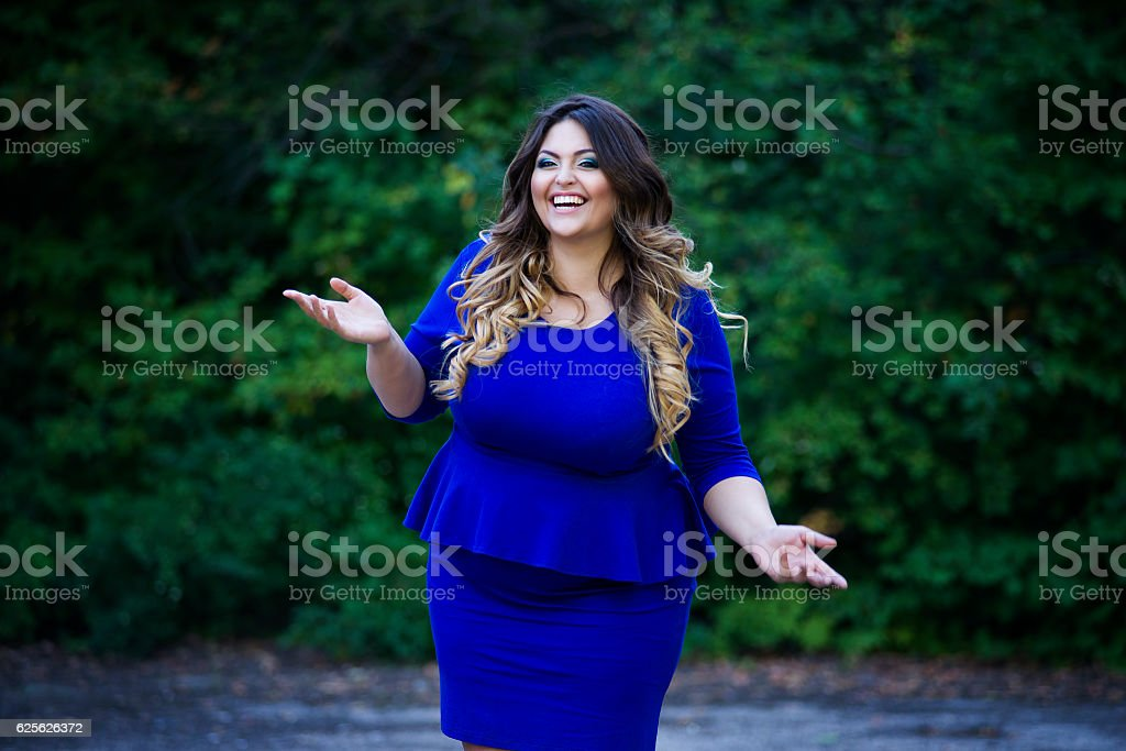 Young happy smiling beautiful plus size model, xxl woman stock photo