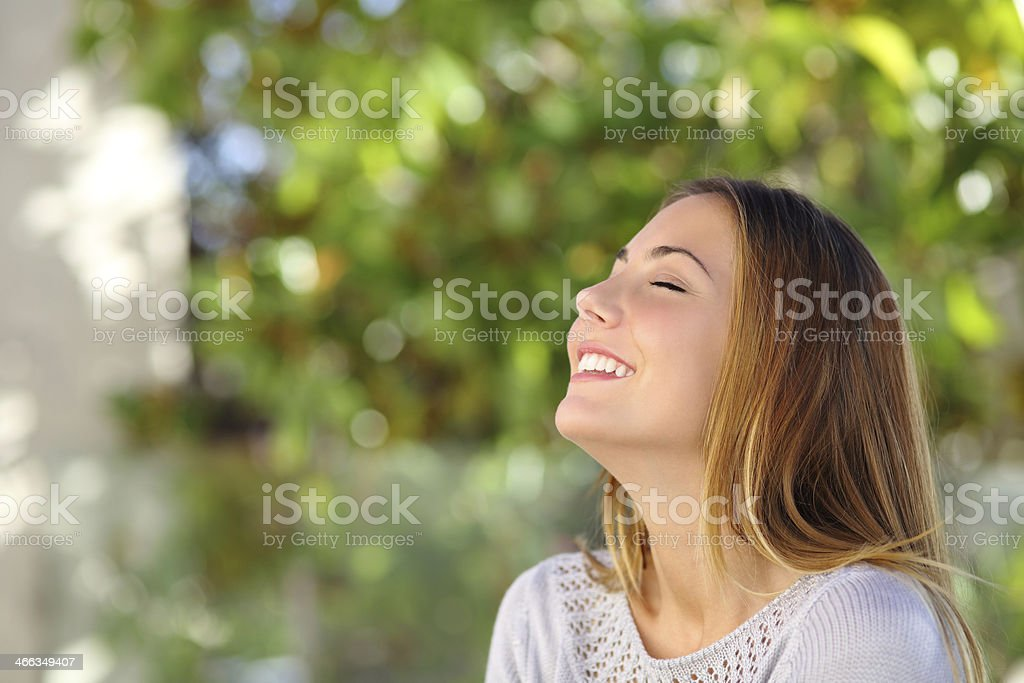 Young happy smiling woman doing deep breath exercises stock photo