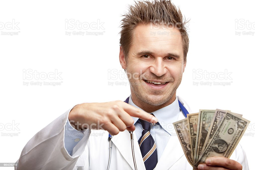 Young happy successful male doctor counting us dollar money stock photo