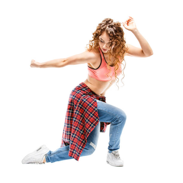 Young happy woman dancing against white background Young happy hispanic woman dancing against white background. Fit dancer girl doing aerobic exercises isolated on white sergionicr stock pictures, royalty-free photos & images