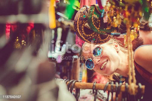 Beautiful woman discover gifts market while travelling Middle East