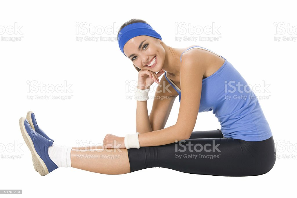 Young happy woman doing fitness exercises, isolated on white royalty-free stock photo