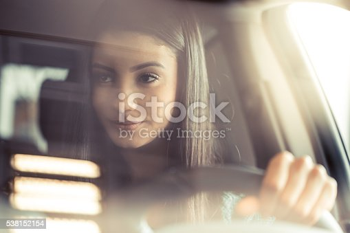 istock Young happy woman driving 538152154