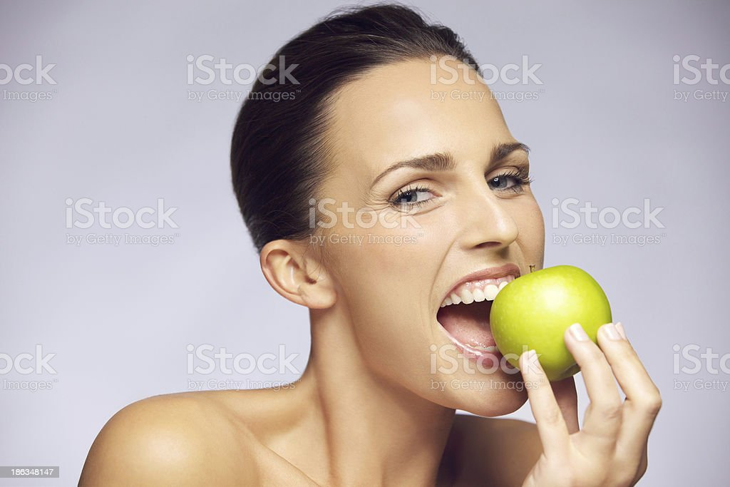 Young happy woman eating green apple royalty-free stock photo