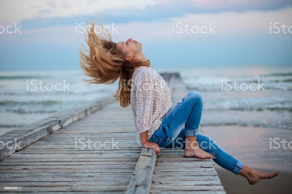 Young happy woman enjoying in day stock photo