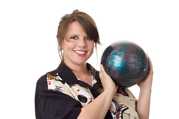 Young happy woman holding a bowling ball stock photo