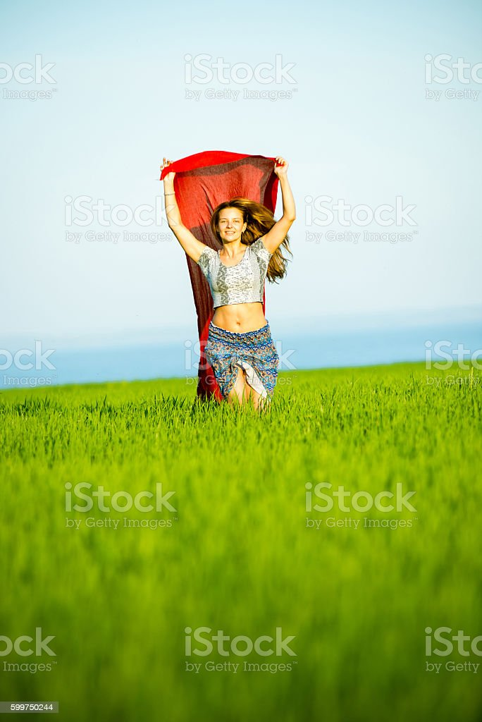 Young happy woman in wheat field with fabric. Summer lifestyle stock photo