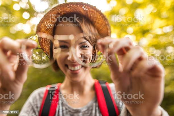 Young happy woman seen through eyeglasses lens in nature picture id538188386?b=1&k=6&m=538188386&s=612x612&h=uq1ndyv0nstnisaewadeaa4vjsreqhzv6x eirjwbo4=