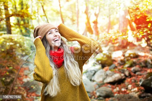 young happy woman smiles in the forest