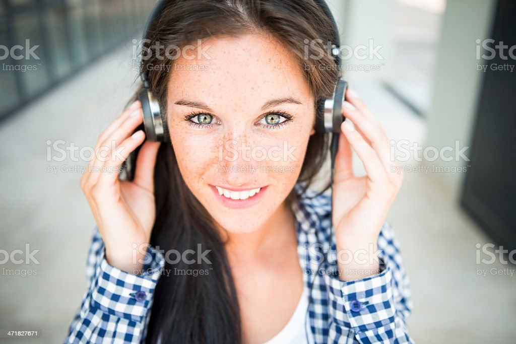 Young happy woman with ear phone royalty-free stock photo