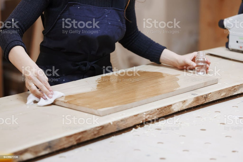 Superb Young Happy Women Standing At A Work Bench In A Carpentry Machost Co Dining Chair Design Ideas Machostcouk