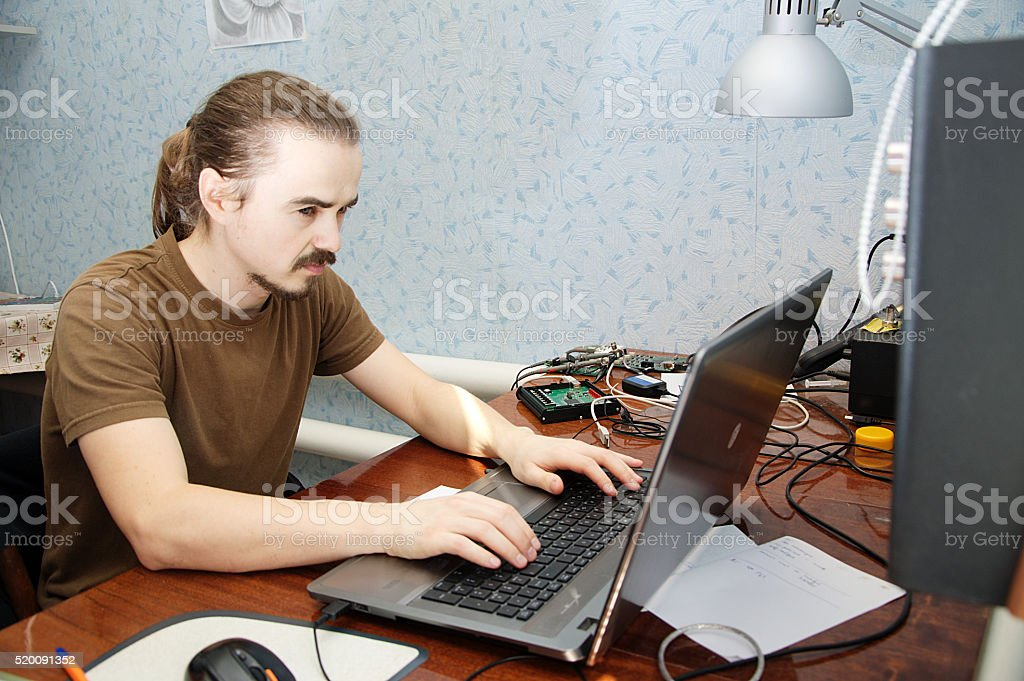 Young hardware engeneer in workplace stock photo