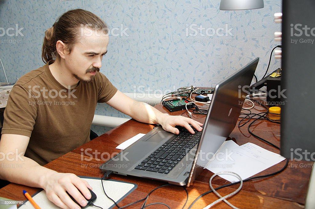 Young hardware engeneer programming stock photo
