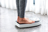 istock Young healthy girl on home scales 641963334
