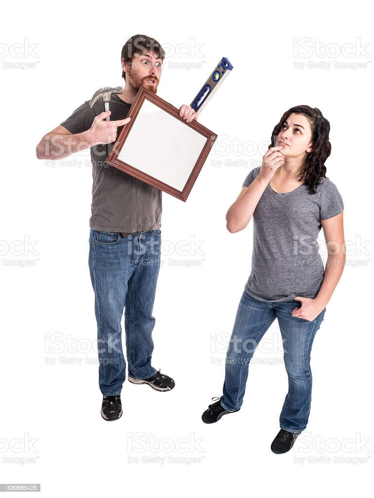 Young Heterosexual Couple Prepares to Decorate Their Home stock photo