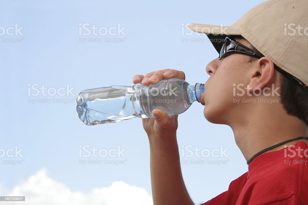 Young hiker drinking water royalty-free stock photo