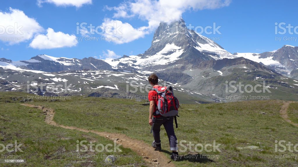 Young Hiker in Alpine Mountains stock photo