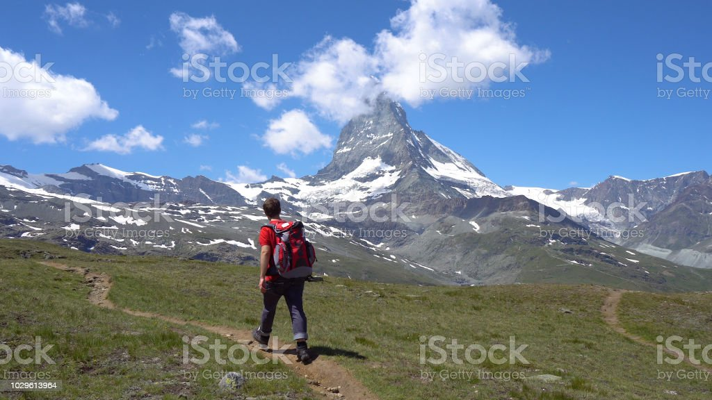 Young Hiker in Alpine Mountains with Room For Text stock photo