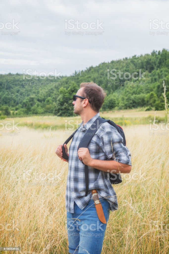 Young hiker in nature / wilderness - trekking outdoors. stock photo