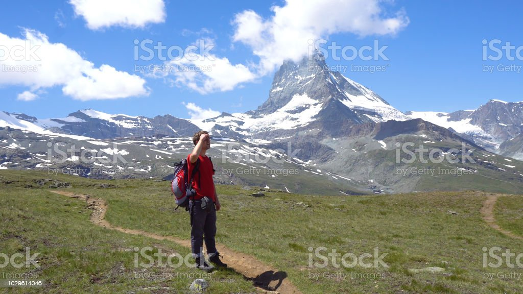Young Hiker in Swiss Mountains with View of Iconic Matterhorn stock photo
