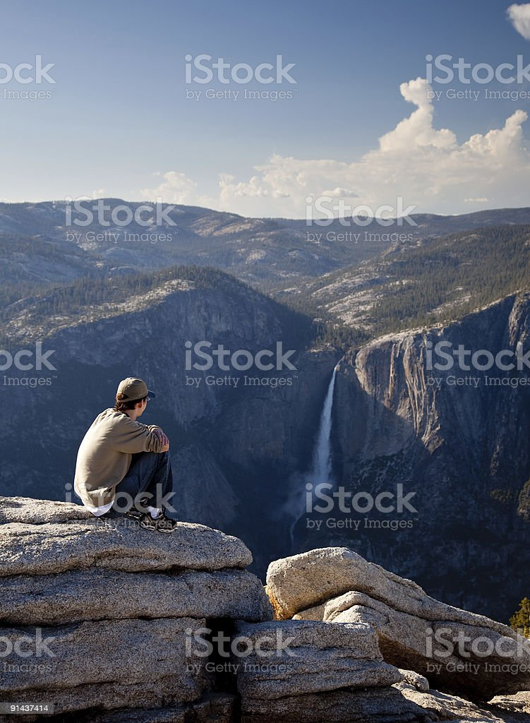 Young hiker overlooking Yosemite falls stock photo