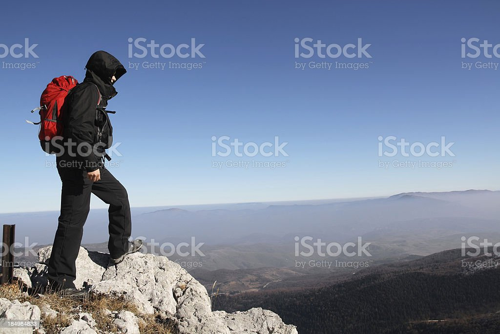 Young hiker standing on top of the mountain royalty-free stock photo