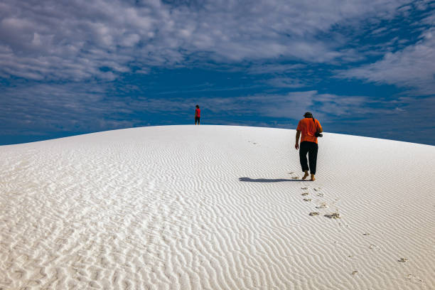Young hikers are walking in the white desert, New Mexico,USA stock photo