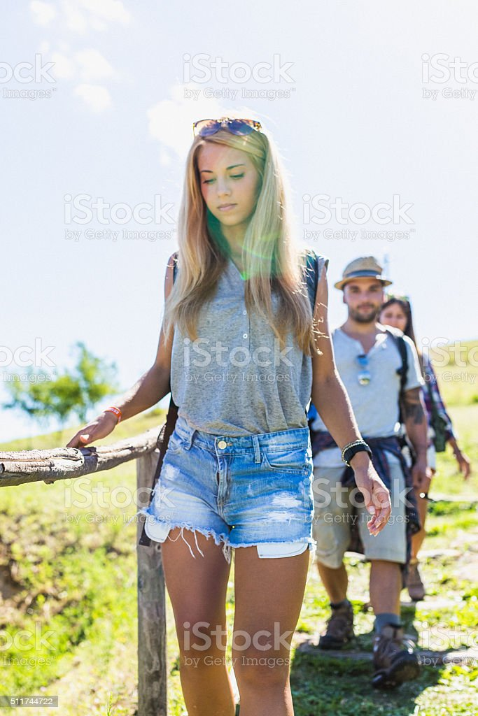 Young hikers walking on country trail stock photo