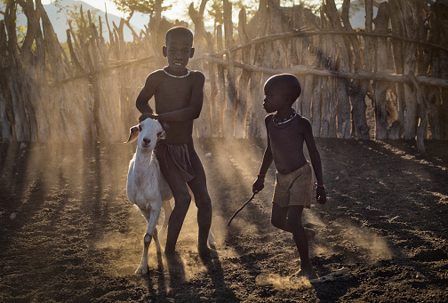 istock Young Himba shepards. 664071522