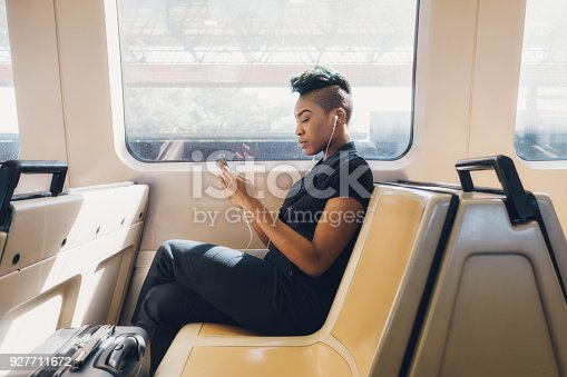 Young hip black businesswoman using her cellphone.