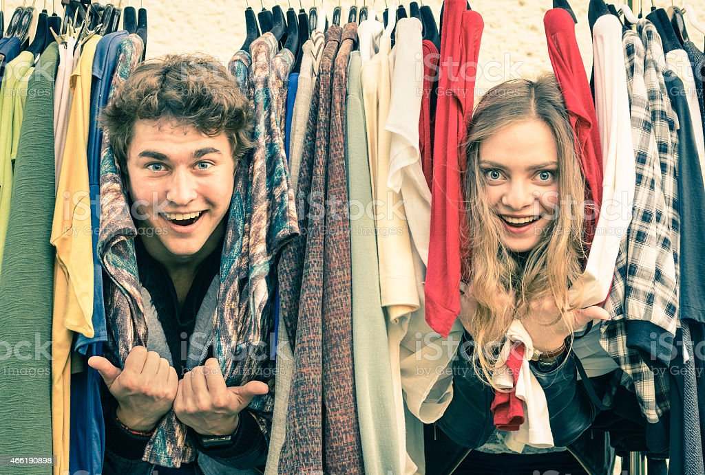Young hipster couple in love at the weekly cloth market stock photo