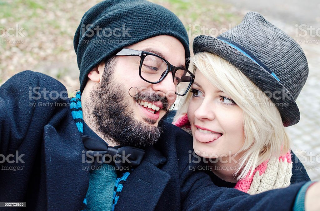 Young hipster couple in love taking selfie stock photo