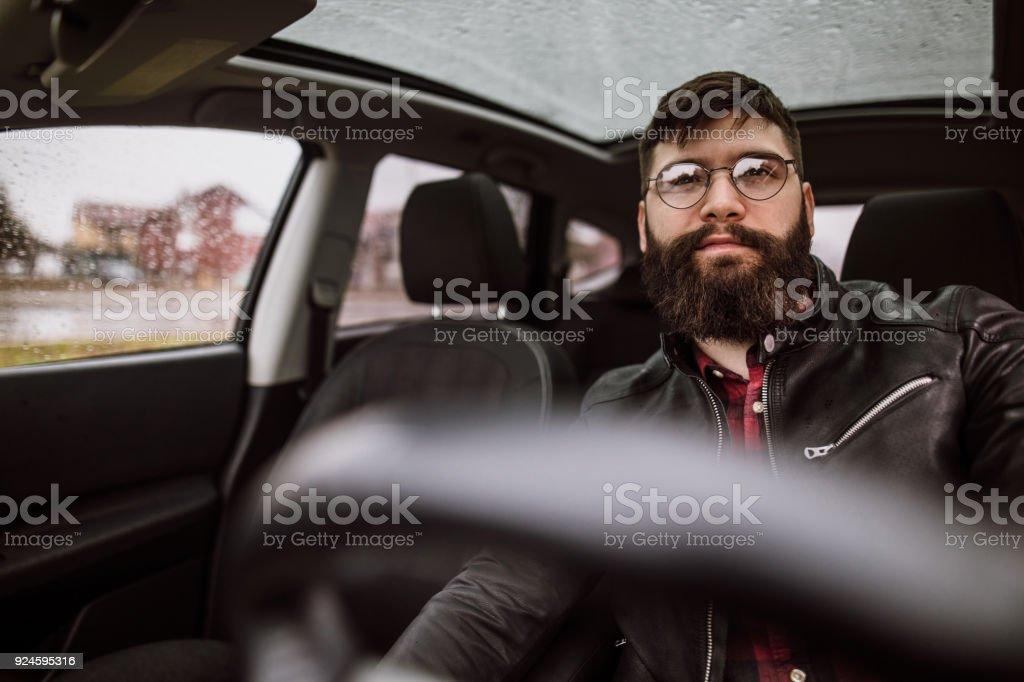 Young hipster driving car stock photo