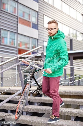 812812808istockphoto young hipster man carrying fixed gear bike in city 482995082