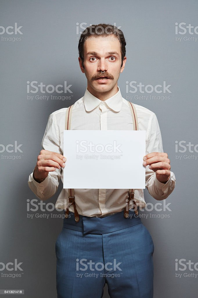 Young Hipster Man Holding a Blank Sheet of Paper stock photo