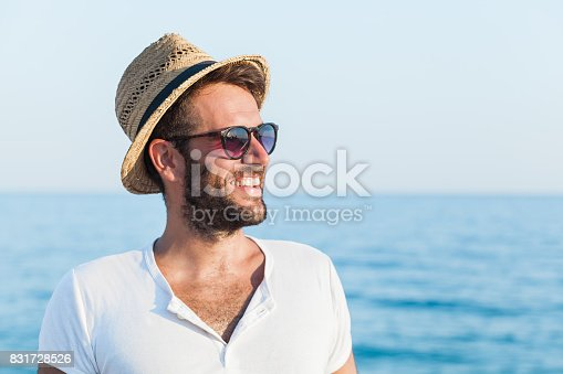 Young hipster man on the beach