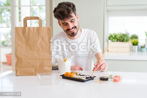 istock Young hipster man using smartphone 1143707123