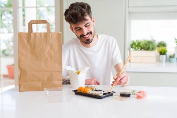 young hipster man using smartphone - food delivery стоковые фото и изображения