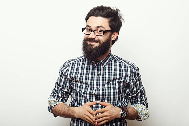 young hipster man with beard - nerd stock photos and pictures