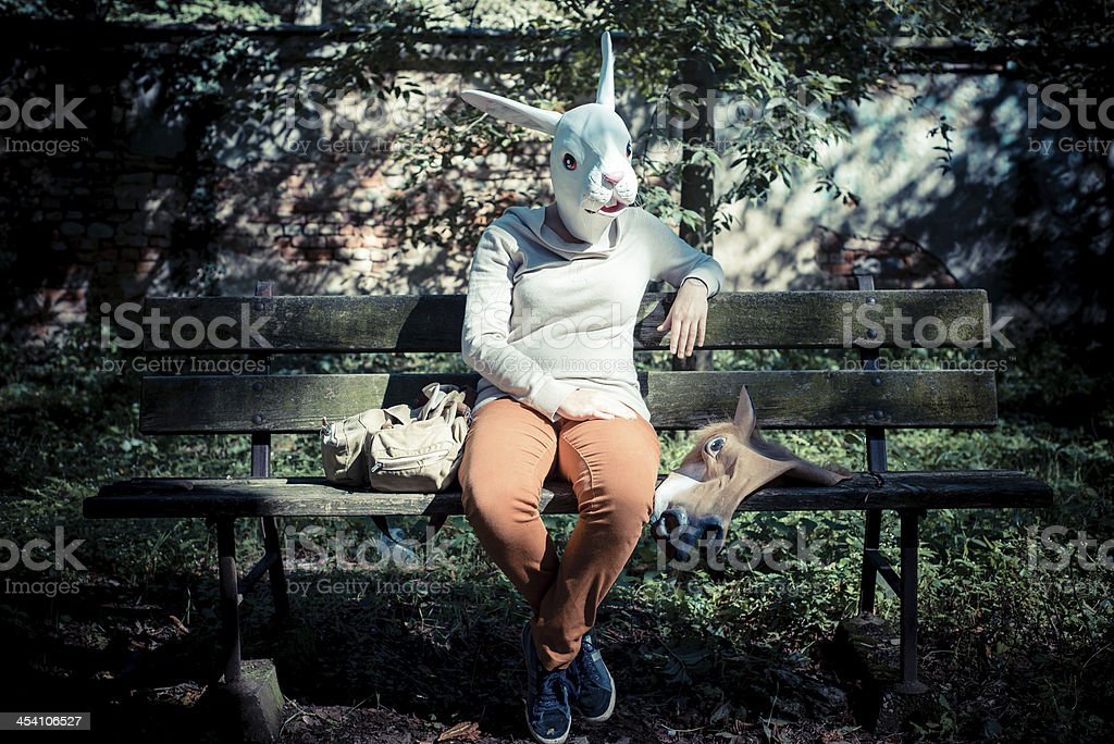young hipster rabbit mask woman in autumn stock photo