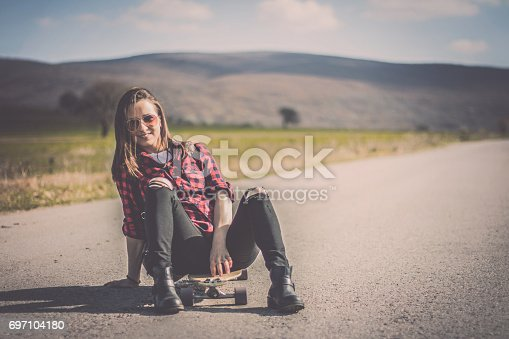 Young hipster riding skateboard on a sunny day