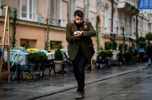 Young hipster running late stock photo