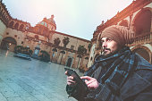 istock young hipster sendig e mails outdoors warm filter applied 468458752