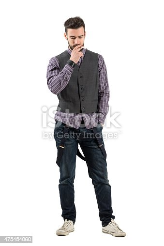 938436312 istock photo Young hipster smoking cigarette looking down 475454060