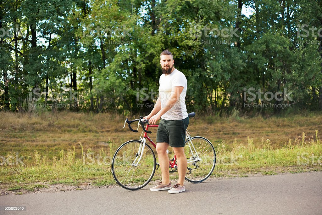 Young Hipster Style Man Posing With Bicycle Stock Photo Download Image Now Istock