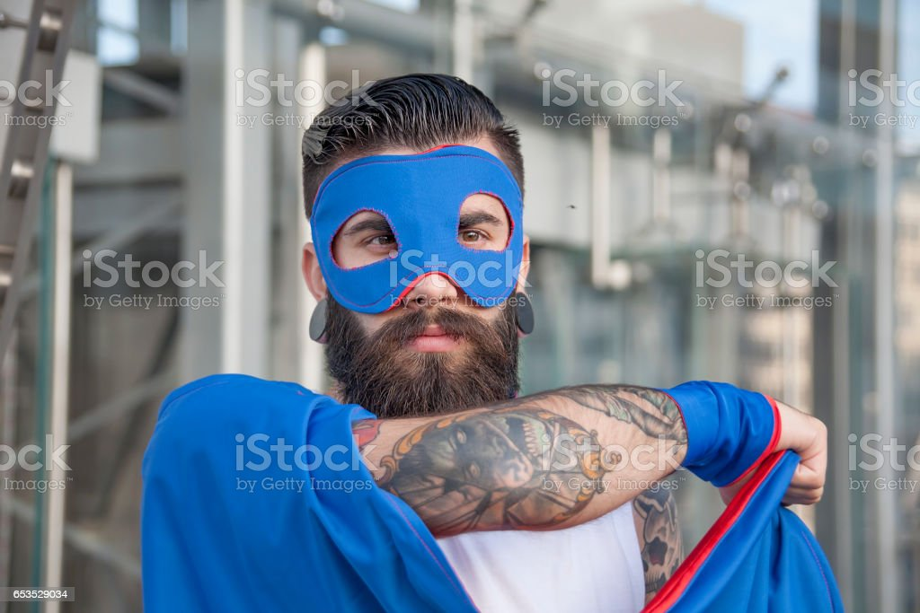 young hipster superhero is protecting the ccenter of town stock photo