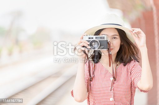 Young Hipster traveler take photo by vintage camera, Travel concept