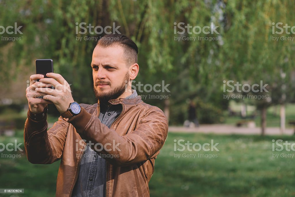 Young hipster using smarphone stock photo