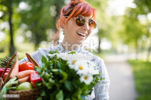 istock Young hipster woman gardening 692530382