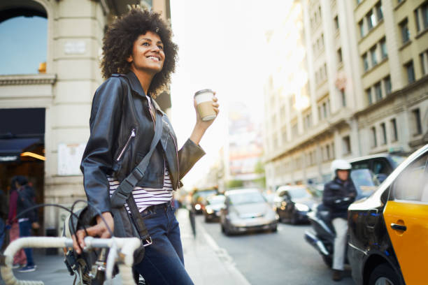Young hipster woman in the streets of Barcelona commuting. Young hipster woman in the streets of Barcelona commuting. Mixed race model, spanish and Ethiopian. leather jacket stock pictures, royalty-free photos & images